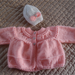 Size 0-6 mths Hand knitted baby jacket / cardigan in coral with beanie