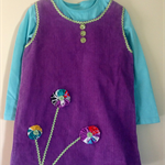 Practical and pretty size 4 Lavender pinafore with floral yo yo trim