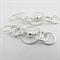 Sterling silver long drop multiple hoop earrings