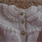 Size 0-6 months: Baby cardigan/jacket in white by CuddleCorner