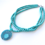 Coastal Howlite turquoise and ceramic statement necklace by Sasha and Max