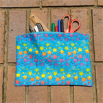 Large pencil case or zipped pouch, colourful stars on bright blue, cotton, lined