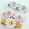 3 beautiful lace daisy clips.