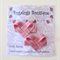 Pair of pink ribbon hearts hair clips
