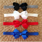 Set of 4 Chic Bow Headbands. Size: Large (2-6 years)