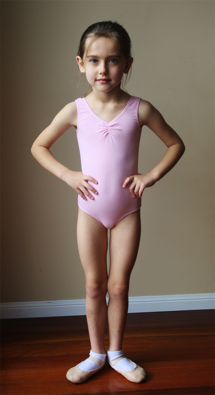 This long-sleeved leotard features a modest scoop neckline and a bra-friendly, high back scoop. Soft, 4-way stretch cotton fabric allows for comfort and ease of movement. Child sizes feature a full front liner, while adult sizes have a shelf bra and crotch liner. Imported. Fabric: Cotton/Polyester/Spandex.