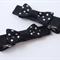 Pair of Black and white polka dot bows.