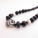 Floral Black and Cream  Onyx and Ceramic  necklace by Sasha and Max Studio