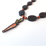 Bugsy carrot pendant orange and green statement necklace by Sasha and Max Studio
