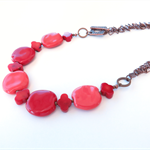 Pop coral, red, orange kazuri and chain statement necklace by Sasha and Max