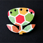 A Wood Flower Brooch With Geometric Hexagon Detail