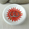 Red Aztec sun porcelain ring dish, candle holder, spoon rest. Ceramic.