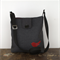 Across body handbag. Quality upholstery fabric with red leather bird detail