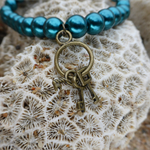 Teal Glass Pearl Bracelet with Key Charm