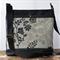 Black bag with beige floral double front pocket   crossbody handbag