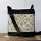 Black bag with beige cream pattern double front pocket   across body bag