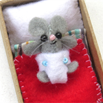 Baby Mouse in a Matchbox Bed - miniature felt mouse