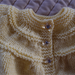 SIZE 0-6 mths - Hand knitted baby cardigan/jacket in yellow: washable, unisex