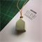 Concrete pendant with leather strap