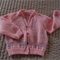 Size 3 - 4 years: Hand knitted cardigan in peach pink with multi colour pattern