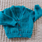 Size 1 year (+) hand knitted unisex cardigan in sea green & white: soft, warm