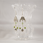 Peridot colour and spring green glass beaded earrings with silver flower bead