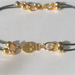 Gold skull bracelet, leather charm bracelet