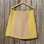 A line 4 panel skirt with bias binding around waist and hem.