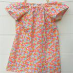 Girls peasant dress with pink, orange, blue & yellow geometric triangle pattern