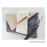 Grey, Apricot and White Leather clutch with copper
