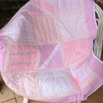 Shades of pink girls cot quilt