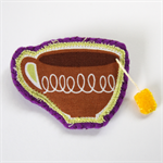 Teacup Brooch with yellow teabag - Brown fabric cup on purple felt.