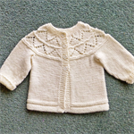 Pure wool baby jacket with circular lace yoke