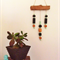 WALL HANGING mint black & natural wood and resin geo beads on wooden branch.