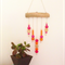 WALL HANGING pink orange wood and clay geo beads on wooden branch.