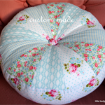 unique round sprocket cushion decor gift. pastel blues, roses designer fabrics