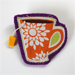 Teacup Brooch with yellow teabag - Orange fabric cup on purple felt.