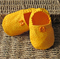 Infant girls bright yellow soft soled shoes.