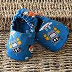 Infant boys robot patterned soft soled shoes.