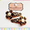 Pair of Leopard Flower snap clips