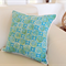 Turquoise & Green Coastal Cushions with Pom Poms 45cm for bedroom or lounge.