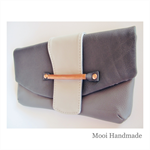 Leather clutch in 3 shades of grey with copper detail.