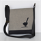 Black and grey canvas messenger bag with black suede bird detail