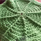 Round, cotton/acrylic washcloth in vibrant green