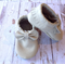 Bow Beige fringed moccasins