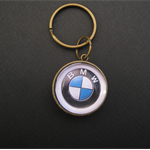 Double sided keyrings. BMW badge on one side, German flag on the other.