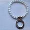 White cats eye bracelet with love token