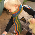Crocheted wavy child scarf | Wool blend| Autumnal red, oranges, greens, blues