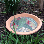 Flowering gum mosaic water dish or bird bath. A lovely piece of garden art