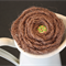 Handmade brown hessian flower with green and red dot wooden button